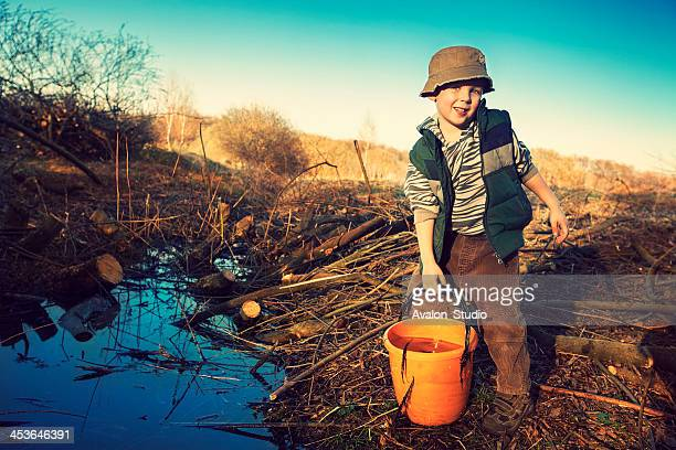 Child and a bucket of water