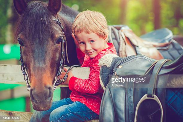 Child and a horse