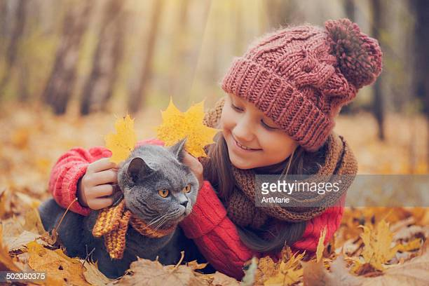 Child and cat in autumn