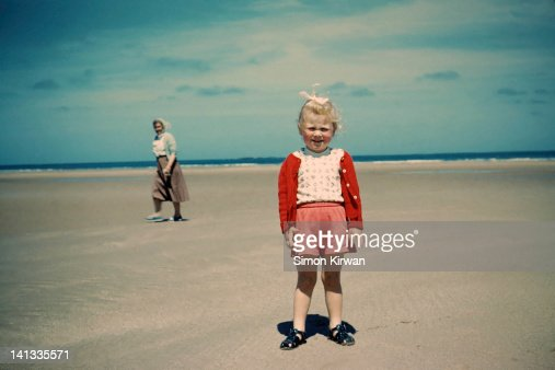 Child and grandmother on beach