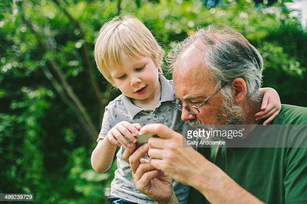 Child and Grandparent using a smart phone