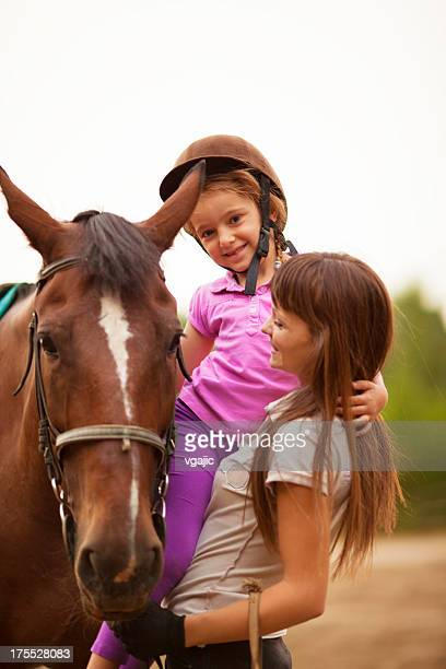 Child and horse outdoors.