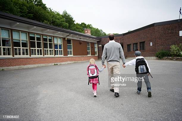 Child and Man Walking to School