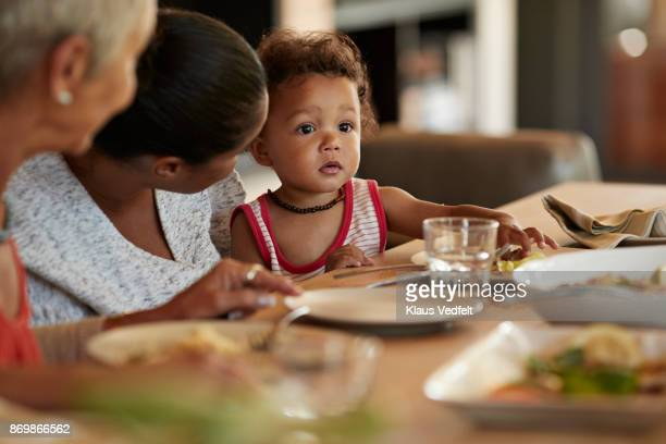 Child and mother at lunch table