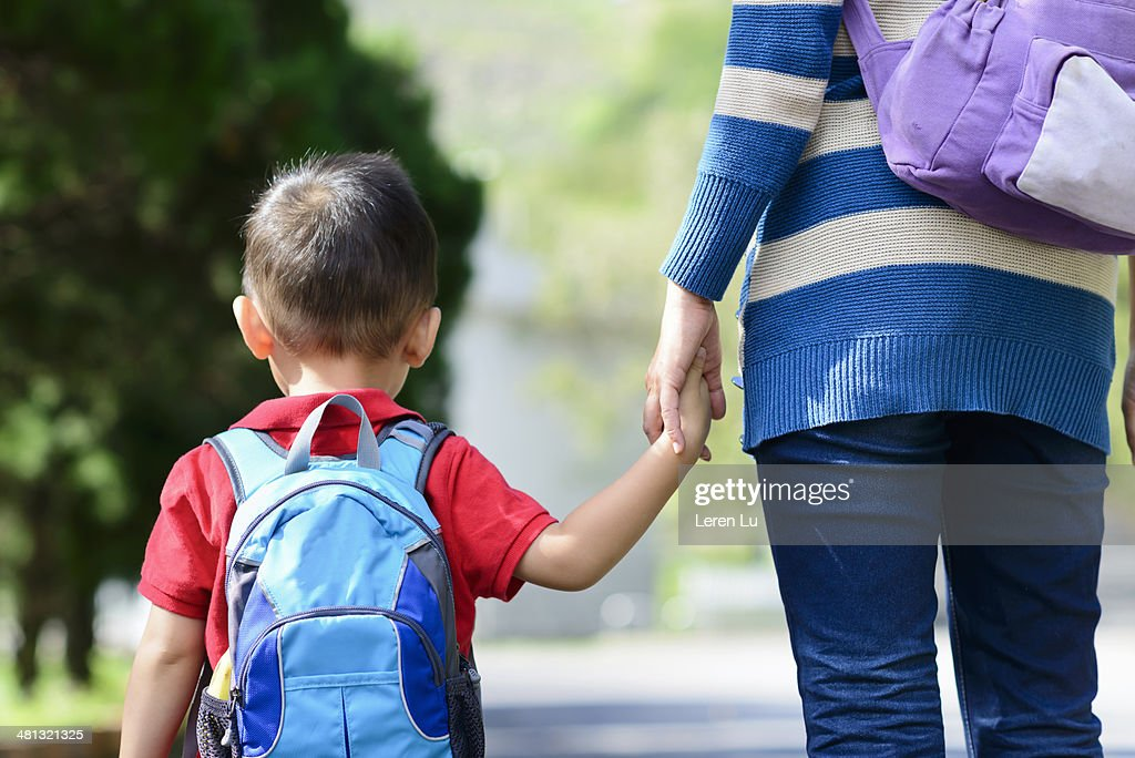 Child and mother walking hand in hand