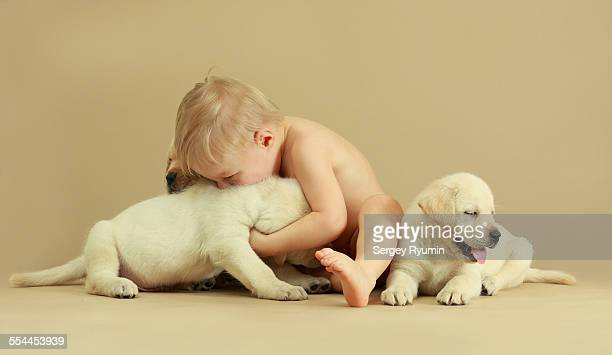 Child and puppies. Hugs