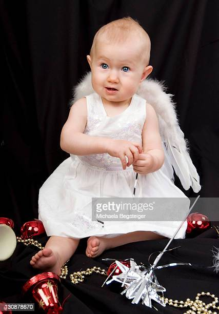 Child as a christmas angel