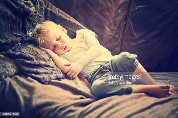 Child asleep on sofa