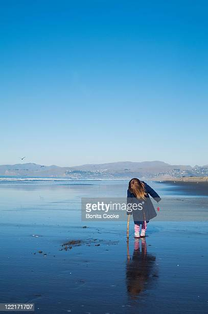 Child at beach in winter