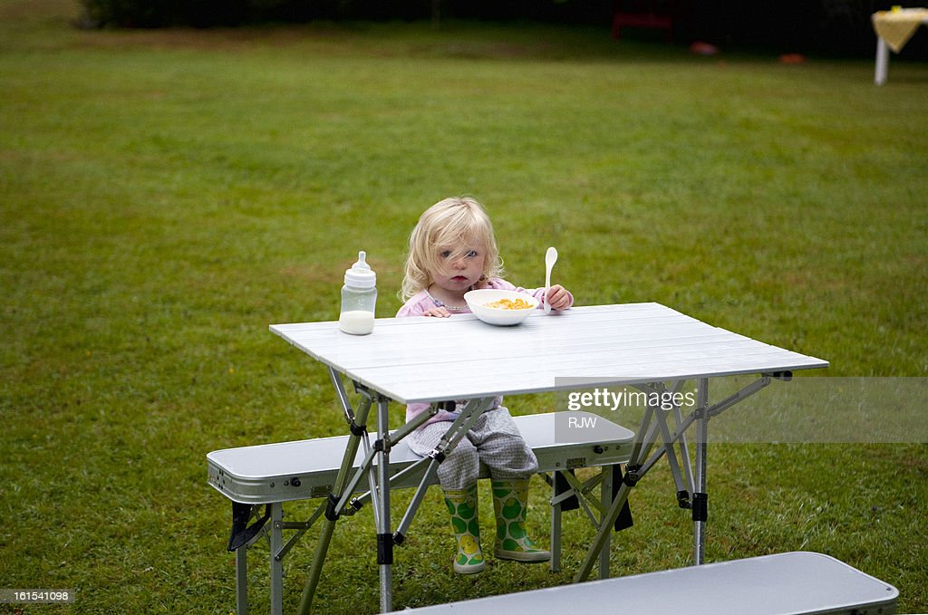 Child at camping table : Stock Photo