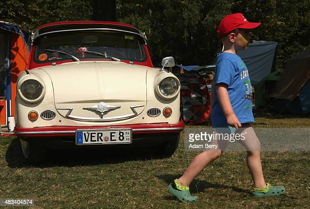 A child attends a Trabant enthusiasts' weekend on August 8 2015 near Nossen Germany The Trabant also called the Trabi is the iconic car of the former...