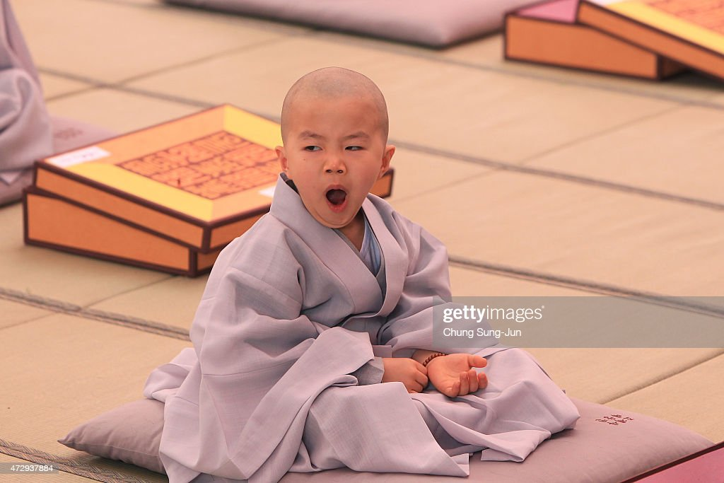 A child attends during the 'Children Becoming Buddhist Monks' ceremony forthcoming buddha's birthday at a Chogye temple on May 11, 2015 in Seoul, South Korea. Children have their hair shaved off during the 'Children Becoming Buddhist Monks' ceremony ahead of buddha's birthday at a Chogye temple. The children will stay at the temple to learn about Buddhism for 14 days. Buddha was born approximately 2,559 years ago, and although the exact date is unknown, Buddha's official birthday is celebrated on the full moon in May in South Korea, which is on May 25 this year.
