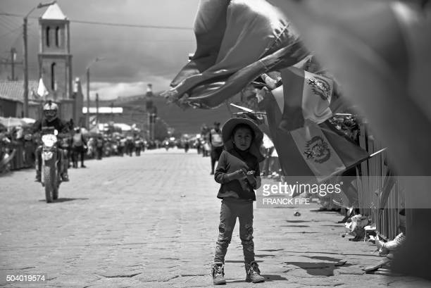 A child attends the end of the Stage 5 of the Dakar Rally 2016 between Jujuy in Argentina and Uyuni Bolivia on January 7 2016 AFP PHOTO / FRANCK FIFE...