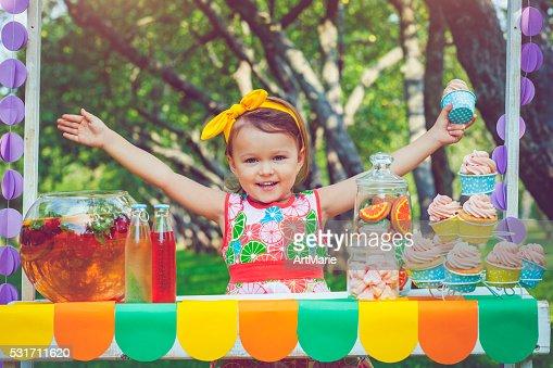 Child behind lemonade stand