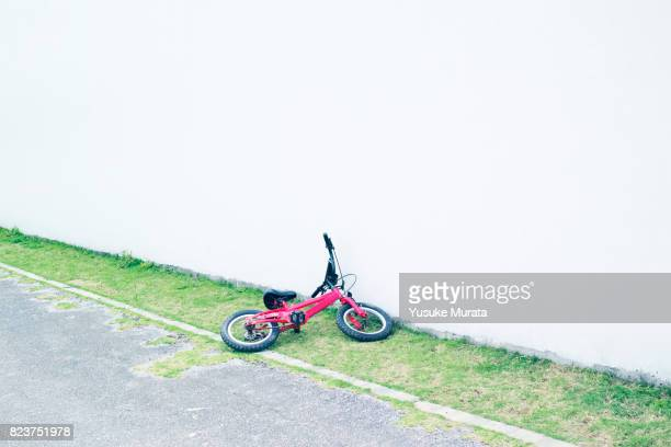 Child bicycle lays flat on the ground