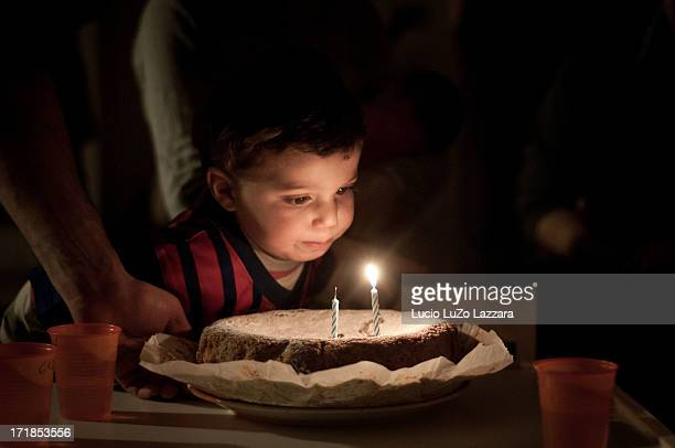 Child blowing candles