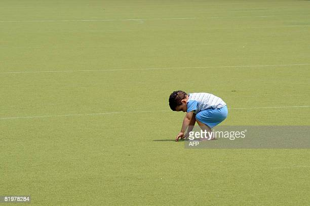 A child bows toward Mecca during the Friday noon prayers in the Vigorelli velodrome in Mailan on July 18 2007 After fifteen years prayers will be...