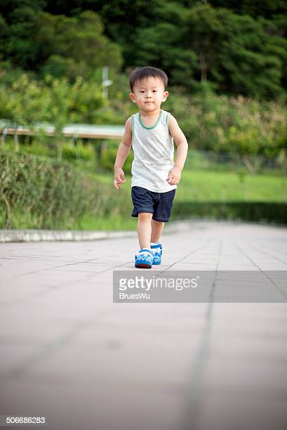 Child boy walking on the ramp