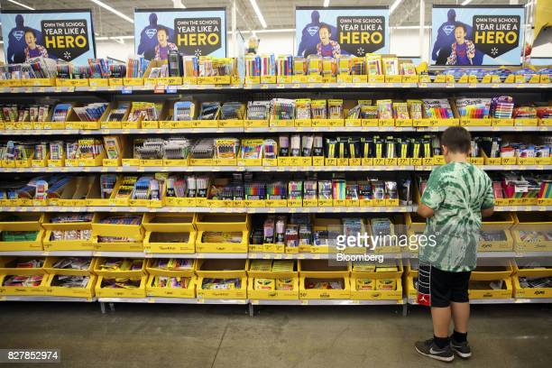 A child browses school supplies displayed for sale at a WalMart Stores Inc location in Burbank California US on Tuesday Aug 8 2017 WalMart Stores is...