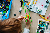 child building robot at robotic technology school lesson, STEM education