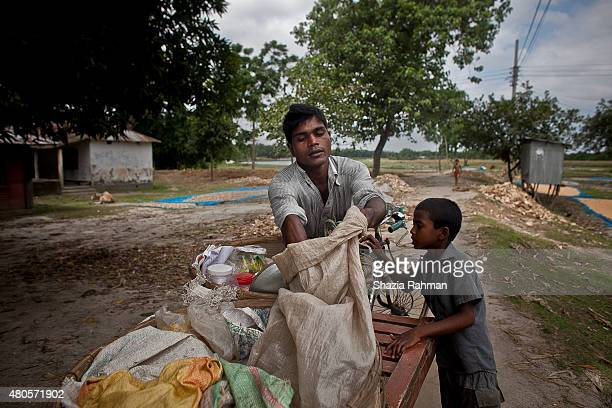 A child buys rice from a mobile vendor in the Bash Kata Indian enclave July 9 2015 in Lalmonirhat District Bangladesh The India Bangladesh enclaves...