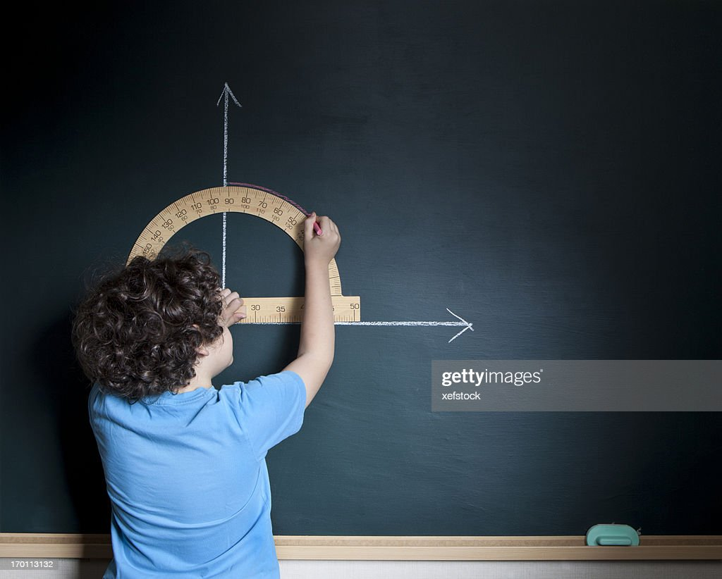 Child calculating on blackboard
