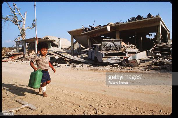 A child carries a jerry can down a road August 8 1982 in Beirut Lebanon In 1982 a siege by Israeli forces led to the expulsion of Palestinian...