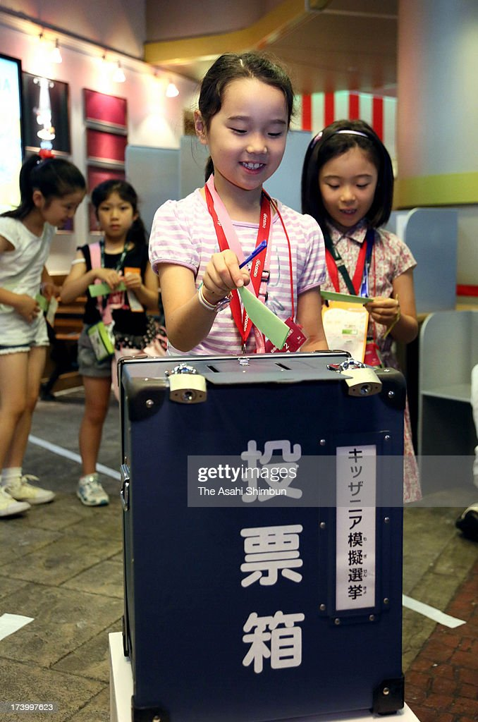 A child cast a vote in straw poll ahead of the upper house election on July 21, at KidZania Tokyo theme park on July 19, 2013 in Tokyo, Japan. The event is held to educate children about electionsystem. KidZania offer children more than 50 career experiences with parents not allowed to help their children during 30 minutes long activities.