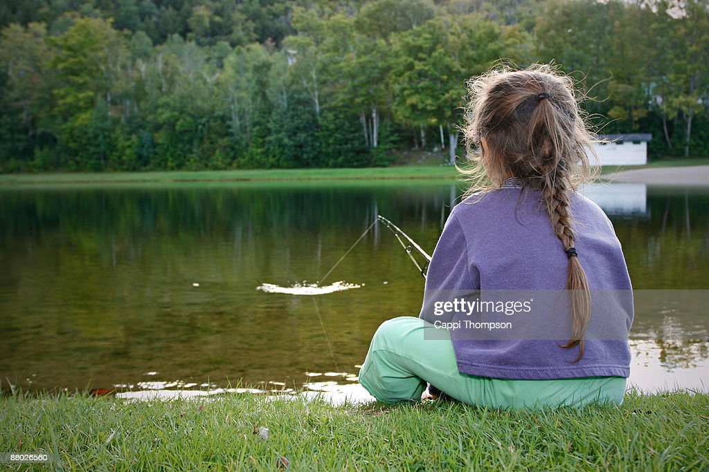 Child catching fish