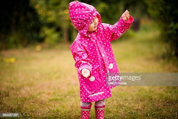 Child catching rain
