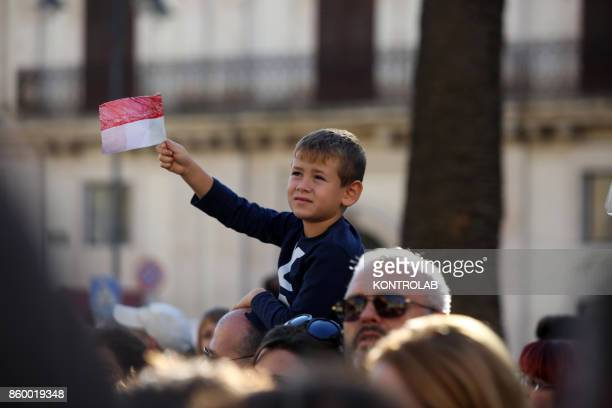 A child celebrates in Modica Sicily southern Italy while they are waiting for Prince Albert II of Monaco