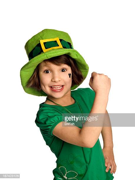 Child celebrating and wearing a Saint Patrick's day outfit