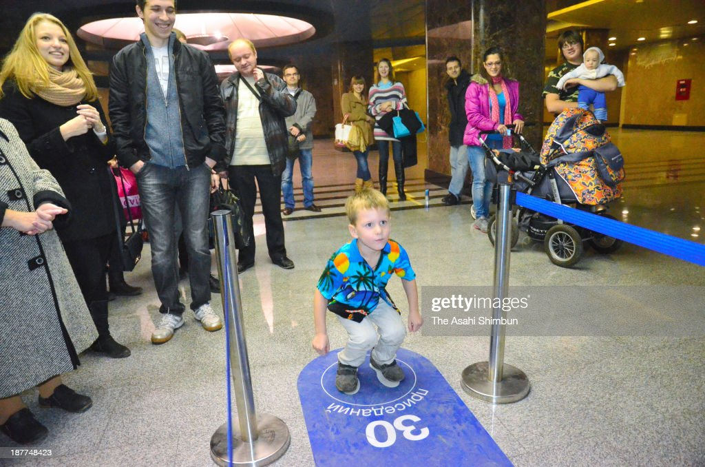A child challenges the 30-squat-in-2-minute at Vystavochaya subway station on November 11, 2013 in Moscow, Russia. Those achieve the squat are rewarded a single ticket. The machine was set on November 8 by the local olympic committee.