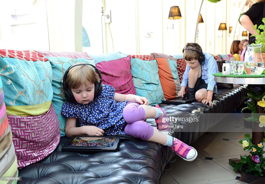 A child checks out the new childrens App 'Henri Le Worm' held at Brasserie Blanc on August 28, 2013 in London, England.