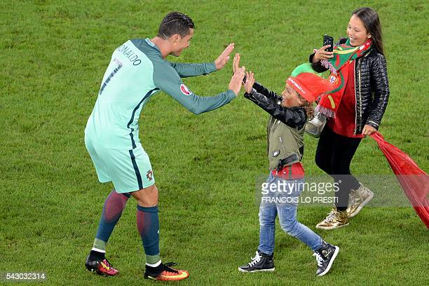 TOPSHOT A child cheers Portugal's forward Cristiano Ronaldo at the end of the Euro 2016 round of sixteen football match Croatia vs Portugal on June...