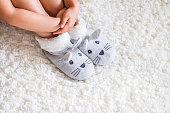Child's feet in slippers.Child. Child's feet in slippers.