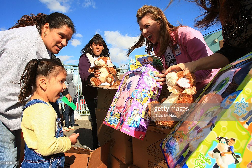 A child chooses a toy as people receive gifts of food, personal care and household items and toys at the Miracle in South Central event, part of the nationwide Miracle on Main Street, USA program to help working poor and disadvantaged families on December 13, 2008 in the South Central neighborhoods of Los Angeles, California. About 5,000 families are expected to receive enough food at the event to supplement meals for a family of four for a week. Miracle on Main Street, USA is sponsored by The National Basketball Players Association (NBPA) along with Feed The Children, Feed 333, Humanity Unites Brilliance (HUB) and hosted by the Salvation Army.