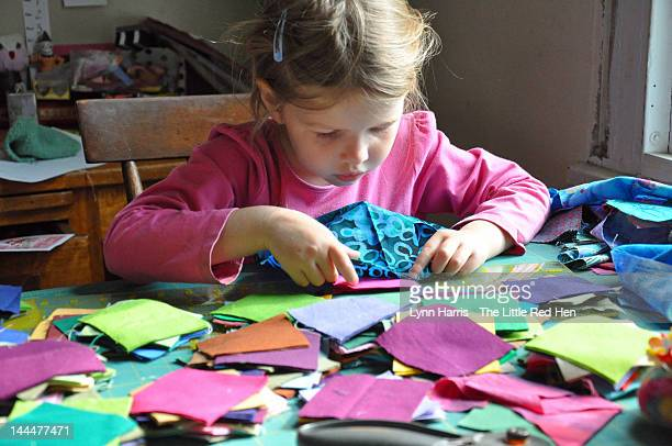 Child choosing fabric colors