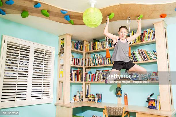 Child climbing in bedroom