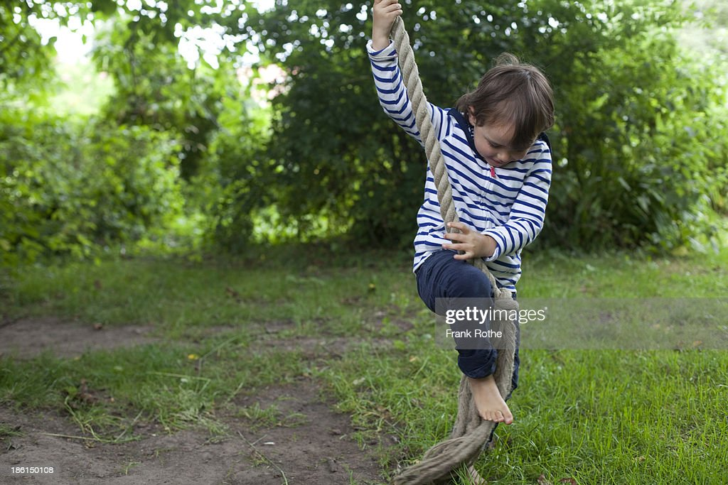 child climbing on a rope : Stock Photo