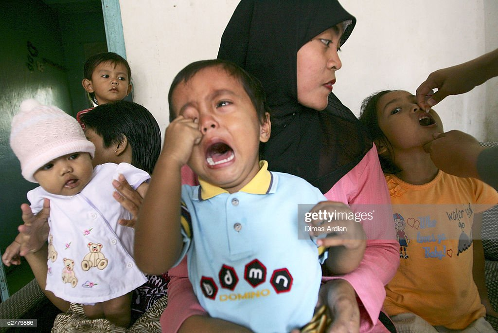 A child cries as he queues to get polio vaccination drops May 9, 2005 at Girijaya village, Sukabumi, Indonesia. Indonesian health authorities confirmed on May 6 that at least four cases of polio with some 15 cases of acute flaccid paralysis have been diagnosed in the West Java province. All cases were found in villages of the Sukabumi district, about 100 kilometres (62 miles) south of Jakarta. An epidemic of polio in Indonesia has broken out after ten years of being free of the disease. Indonesia is the 16th previously polio-free country to be reinfected in the past two years, including 13 in Africa, according to the United Nations health agency.