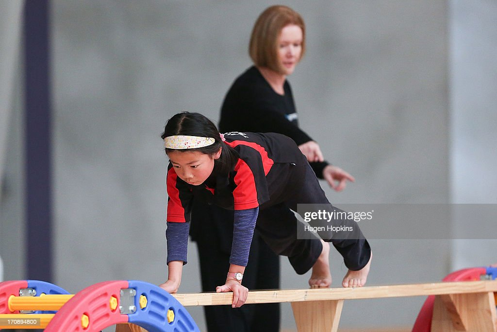 A child crosses a beam during the launch of the New Zealand Olympic Ambassador Programme at ASB Sports Centre on June 20, 2013 in Wellington, New Zealand.