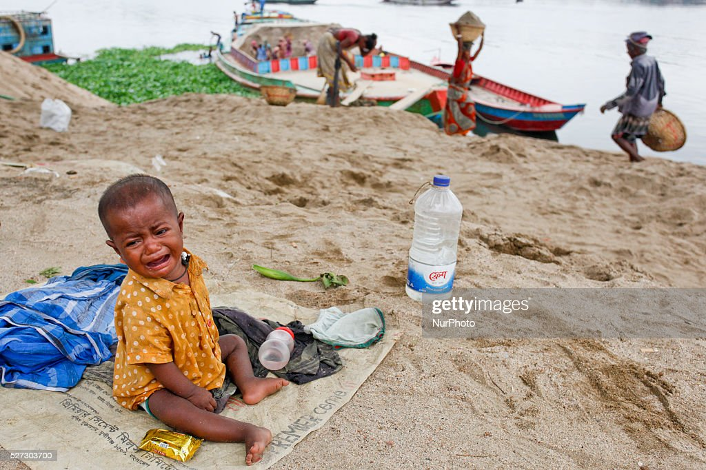 Child cry close to river in Dhaka, Bangladesh, on May 2, 2016. Poor working family usually cannot take proper care of their infant as most of the day both husband and wife is busy to earn their living for the day and there is no day care center for them.