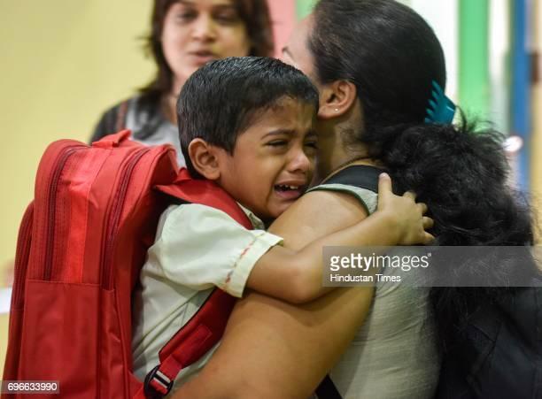 A child crying on the first day of school at Sane Guruji English Medium High School in Dadar on June 15 2017 in Mumbai India Attired in brandnew...