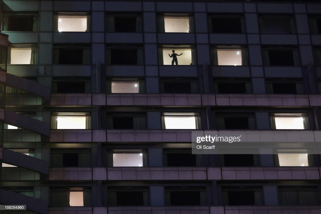 A child dances in the window of a room in the Hilton London Metropole hotel in Paddington on November 1, 2012 in London, England.