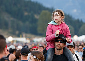 A child dances on top of her dad's shoulders while watching DJ Snake's performance onstage during day 4 of Pemberton Music Festival on July 17 2016...