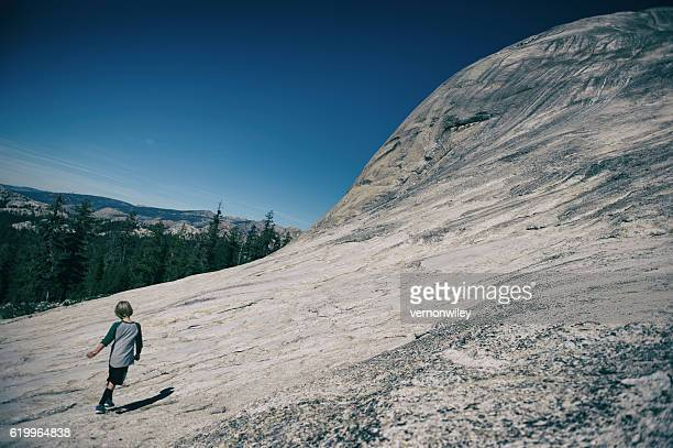 Child dancing on a mountain in Tuolumne Meadows, California