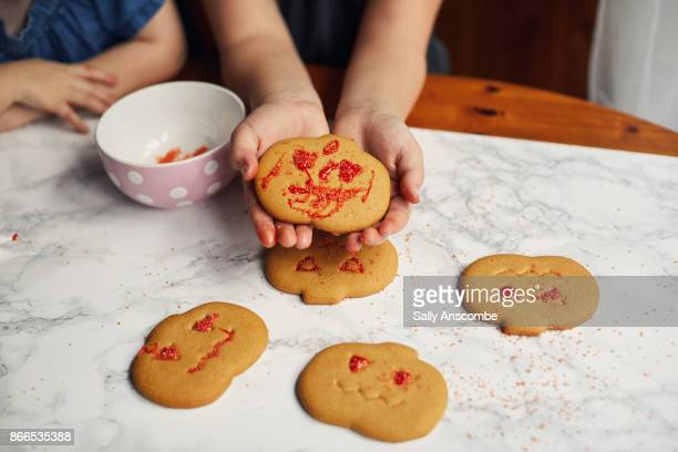 Child decorated biscuits for Halloween