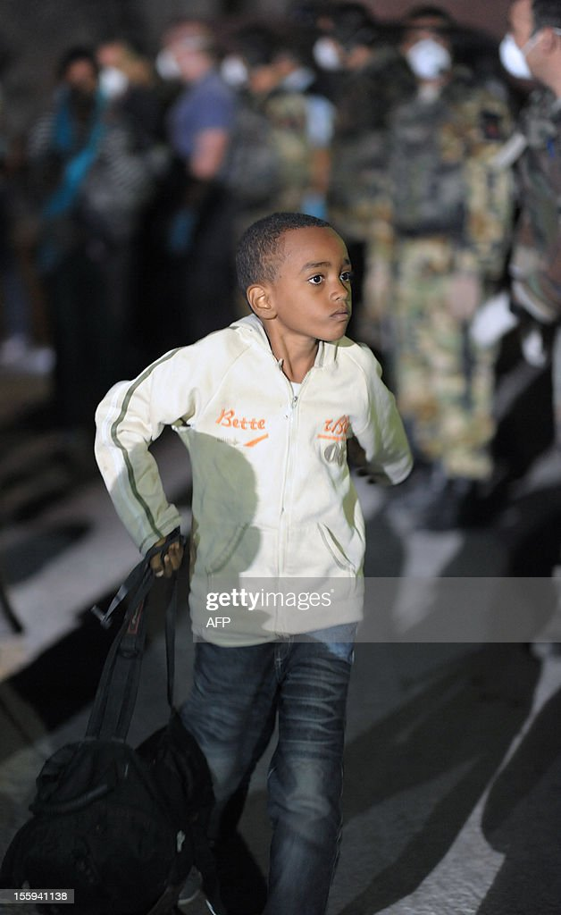 A child disembarks from an Armed forces patrol boat with other migrants after being rescued early on November 9, 2012 in Valletta. The Maltese military rescued 250 undocumented migrants believed to be Eritrean from a stricken boat, officials said, after reports the vessel had been adrift for days. AFP PHOTO/Matthew Mirabelli -MALTA