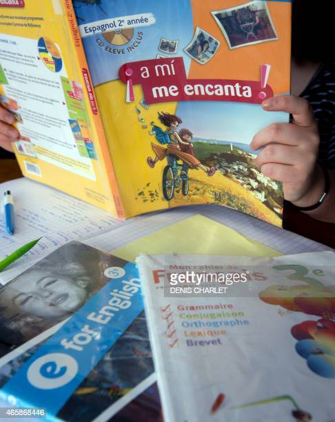 A child does homework on March 11 2015 in the northern French city of Lille French Education Minister Najat VallaudBelkacem presented on March 11...